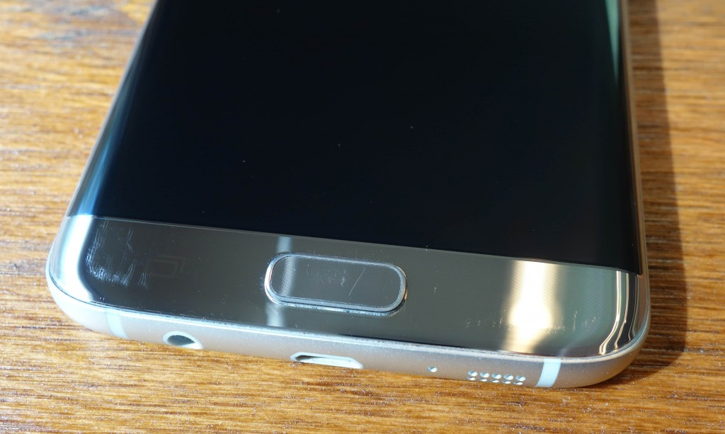 Multitude of scratches by the left and right capacitive buttons, and on the Home button