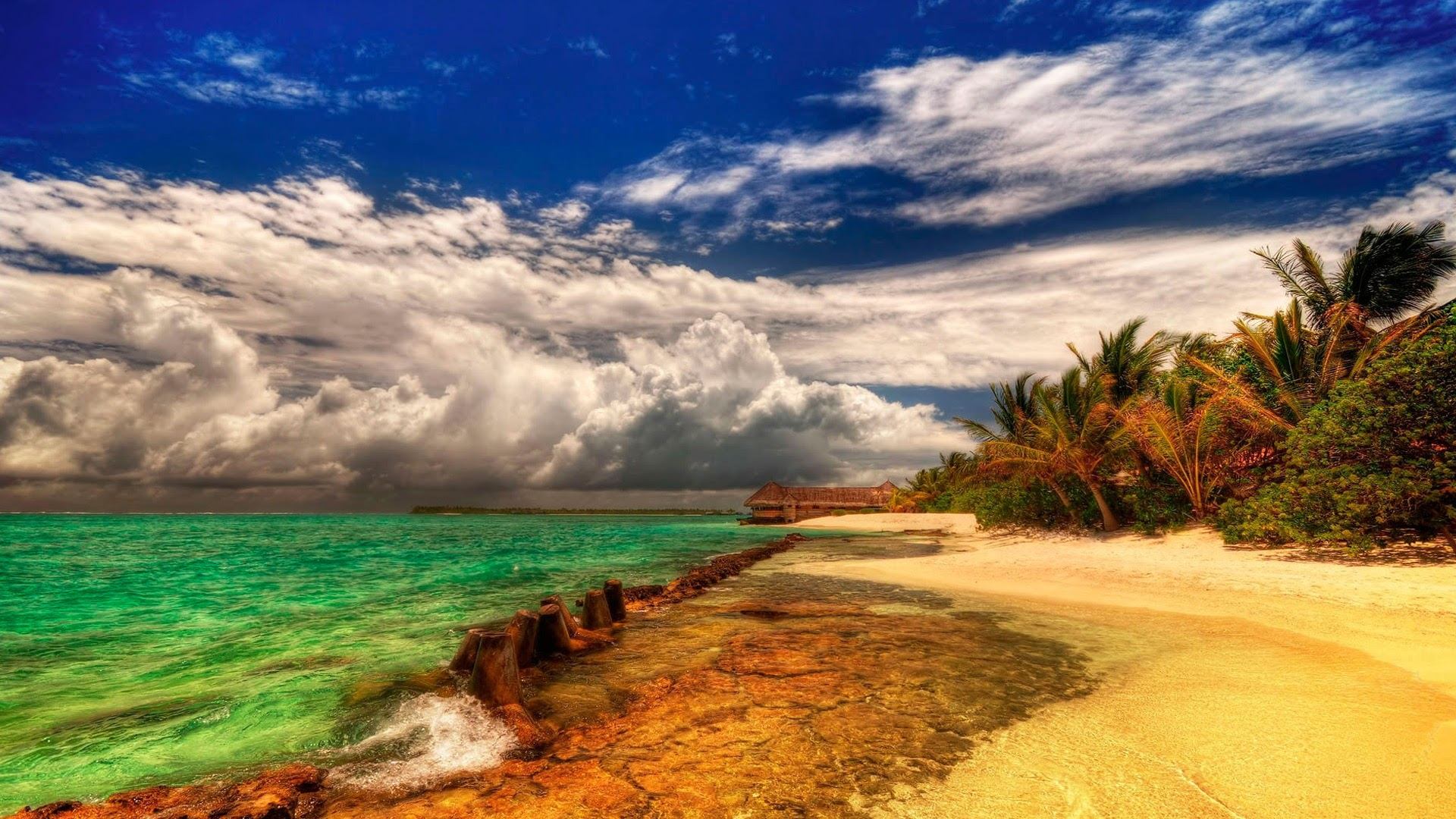 Summer beach and green waters Wallpapers
