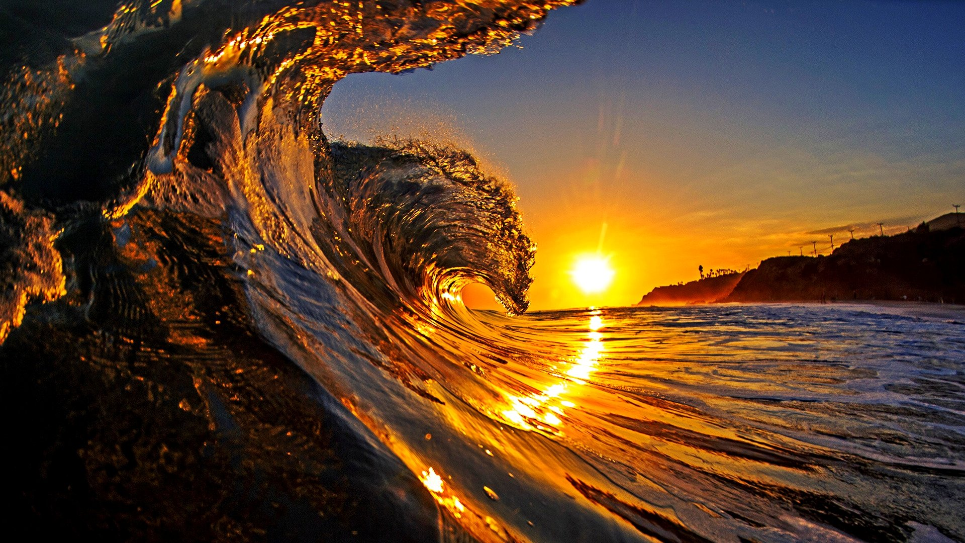 Majestic wave at sunrise, California, USA --- Image by © David Pu'u/Corbis