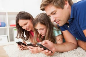 family-using-smartphones-shutterstock-510px